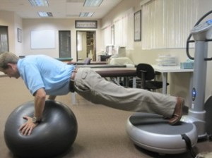 Pushups on exercise ball for shoulder strength.