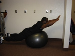 back extension exercises on exercise ball